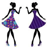 Slim stylish girls in short dresses. Slim stylish young models in short dresses mainly with blue and violet colors, vector stencils isolated on the white Stock Photography