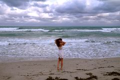Girl on the background of the ocean walking and having Holidays at the seaside stock photos