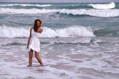 Smiling girl near the ocean stock image