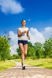 Slim tall girl running in the park Royalty Free Stock Photo