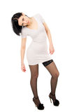 Slim, tall girl standing in stockings Stock Photography
