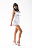 Slim tanned model with long legs in sexy dress Royalty Free Stock Photo