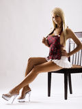 Slim tanned model in white skirt Royalty Free Stock Photos