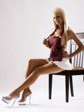 Slim tanned model in white skirt Royalty Free Stock Photos