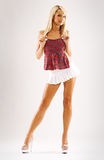 Slim tanned model in white skirt Stock Photos