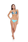 Slim tanned woman in blue bikini Royalty Free Stock Photography