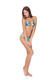 Slim tanned woman in blue bikini Royalty Free Stock Photo