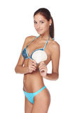 Slim tanned woman in blue bikini Royalty Free Stock Image