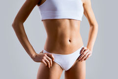 Slim tanned woman's body Royalty Free Stock Photography