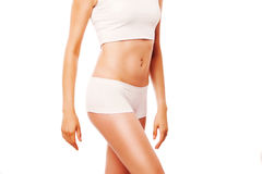 Slim tanned woman's body. Isolated over white Royalty Free Stock Images