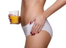 Slim tanned woman's body, orange juice in hand. Isolated on whit Stock Images