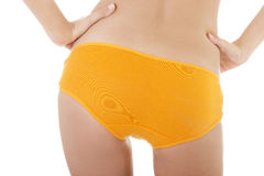 Slim tanned woman's body in orange panties. Stock Photography