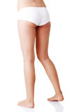 Slim tanned woman's body in white panties. Royalty Free Stock Photography