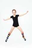 Slim teen girl doing gymnastics dance in jumping on white Royalty Free Stock Photography