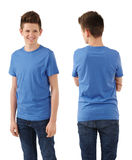 Slim teenager with blank blue shirt Royalty Free Stock Image