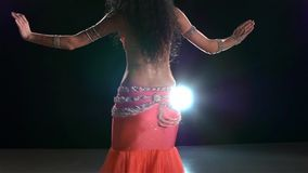 Slim torso of a beautiful belly dancer on a black stock footage