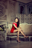 Slim trendy, luxurious, fashion woman in  lux vintage interior. Stock Image