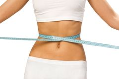 Slim waist. Woman showing how much weight she lost Royalty Free Stock Image