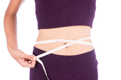 Slim waist beauty women with a tape measure. Slim waist beauty woman with a tape measure her shape Royalty Free Stock Image