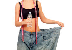 Slim woman back with huge pants and water bottle Stock Image