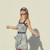 Slim Woman basking in the sun Stock Photo