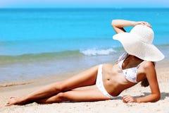 Slim woman on a beach. Royalty Free Stock Image