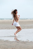 Slim woman with beautiful body wearing mini skirt and bra pose at the beach Royalty Free Stock Photos