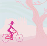 Slim woman with bicycle in a park Royalty Free Stock Photography