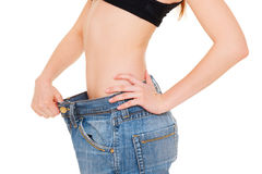 Slim woman in big jeans Stock Photos