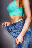 Slim woman with big jeans Royalty Free Stock Image