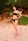 Slim woman in bikini drink coconut milk Stock Image