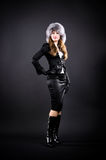 Slim woman in black clothing and fur cap Royalty Free Stock Photos