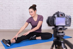 Slim woman blogger making video about sport Stock Image