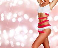Slim woman body on an abstract background Royalty Free Stock Photo
