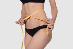 Slim woman body in black underwear measurement on white backgroud. Slim woman body in black underwear measurement on white Stock Image