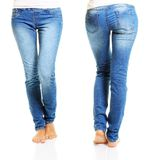 Slim woman body in blue jeans Royalty Free Stock Images