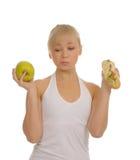 Slim woman choosing between apple and hamburger Stock Photo