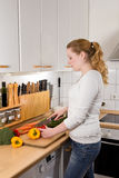 Slim woman cutting vegetables kitchen Royalty Free Stock Image