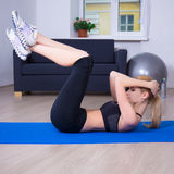Slim woman doing exercises for abdominal muscles Royalty Free Stock Image