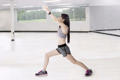Slim woman doing warm-up at gym Stock Photos