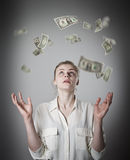 Slim woman and dollars. Girl with her hands up. Young slim woman in white and falling dollar banknotes. Currency and lottery concept Royalty Free Stock Photos