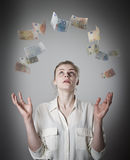 Slim woman and euro. Girl with her hands up. Young slim woman in white and falling euro banknotes. Currency and lottery concept Royalty Free Stock Images