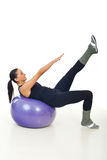 Slim woman exercising on ball Stock Photos