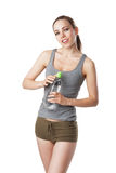 Slim woman in fitness dress holding a water bottle Stock Photography