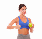 Slim woman giving ok sign to fitness Royalty Free Stock Photo