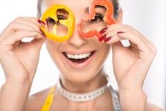 Slim woman having fun with healthy food Royalty Free Stock Image
