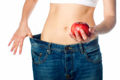 Slim woman holding apple royalty free stock image