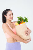 Slim woman holding bag with healthy food Royalty Free Stock Photo