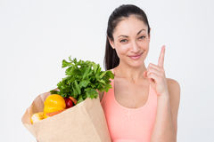 Slim woman holding bag with healthy food Stock Photography