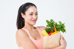 Slim woman holding bag with healthy food Royalty Free Stock Photos